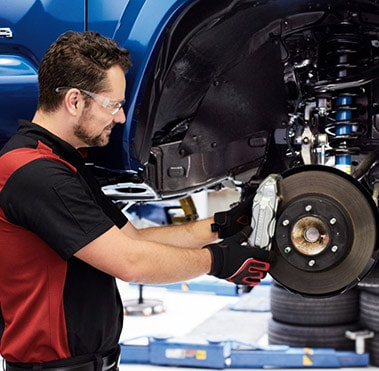 Toyota Technician working on brakes